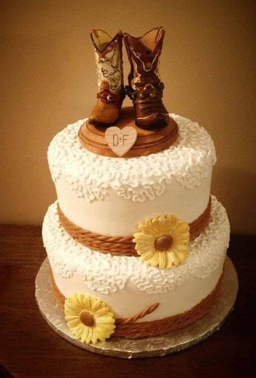 2-tier wedding cake with boot figurines