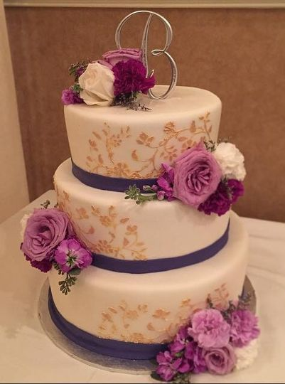 3-tier wedding cake with purple and gold details