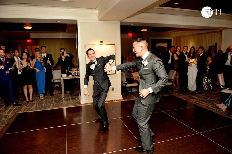Groom and best man on the dance floor