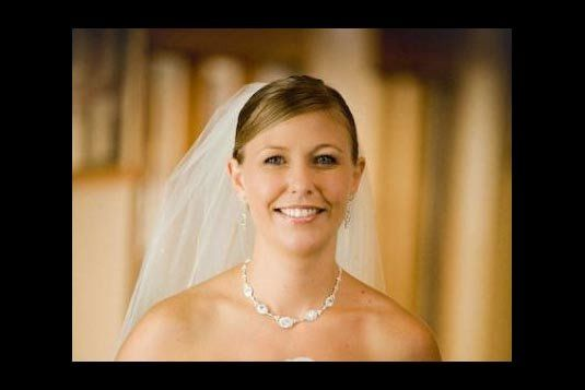 A beautiful, happy bride on her wedding day.  We did a natural eye and a nude lip on her.