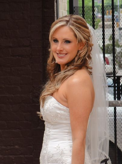A beautiful, excited bride on her wedding day.  We featured a smokey eye on her.