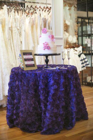 Purple ruffled table linen