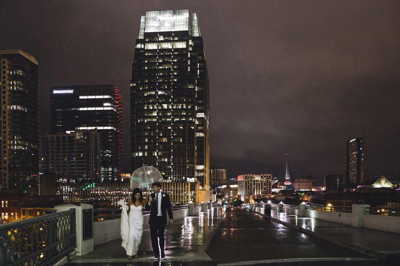 pedestrian bridge night portrait bridgestone rain