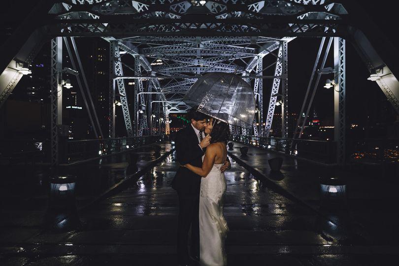 pedestrian bridge night portrait umbrella rain kis