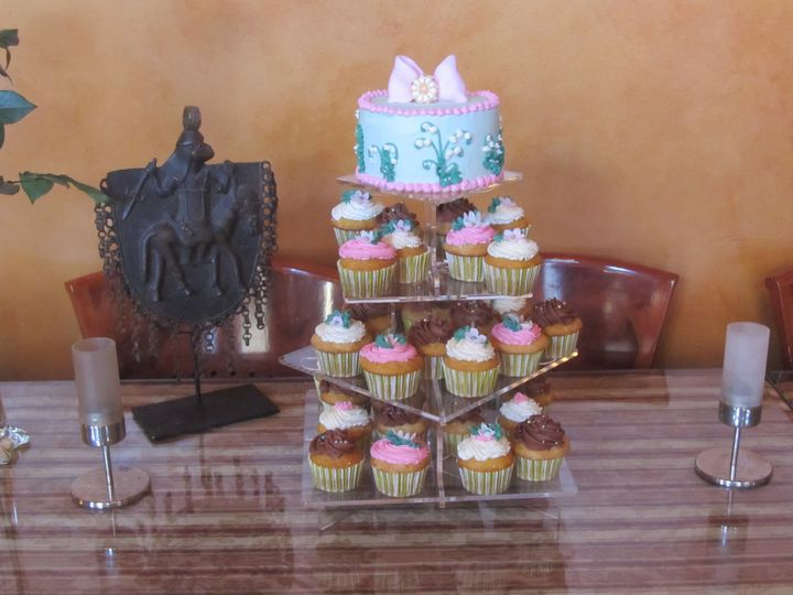 "Spring wedding, 6"" top with bow and edible medallion.  Spring flower cupcakes."