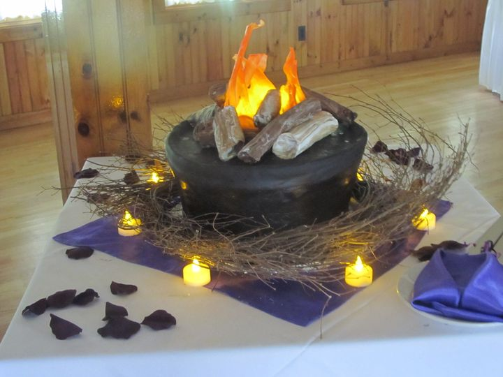 Camping themed wedding.  Cake is completely edible including the flames.  They are made out of...