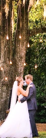 Couple with hanging lights