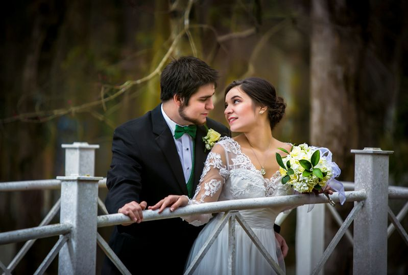 bridal couple on a bridge