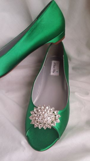 green kitten heels with sparkling oval brooch