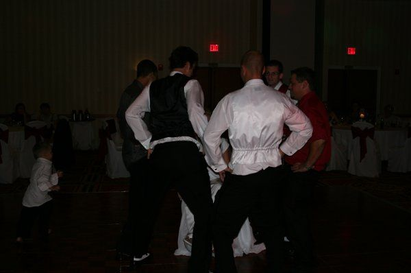 Bride is surrounded by Groom and Groomsmen dancing around her!