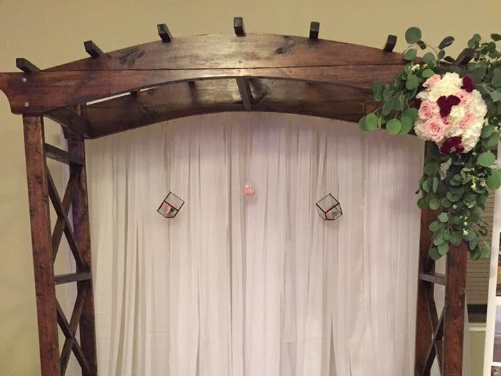 Tmx 1528383769 0dbe72f687143e12 1528383767 1b8fdd5d11ac2620 1528383764648 6 Wooden Arch Show Daytona Beach, FL wedding planner