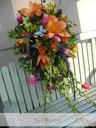 CT spring modern wedding cascade bouquet with lilies, tulips, orchids, kangaroo paws, fiddle heads,...