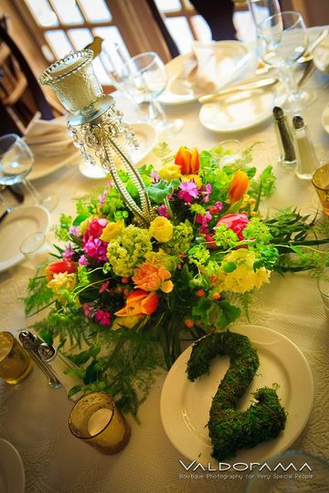 CT spring wedding centerpiece in pink, yellow, green, apricot, and lavender with tulips, viburnum,...