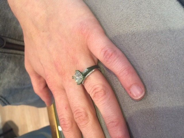 Elegant custom made cushion cut engagement ring with tapered baguettes.