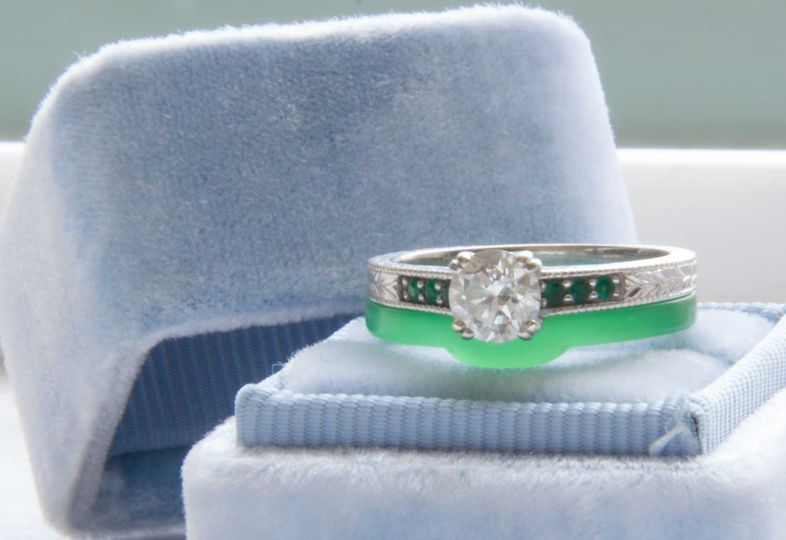Classic, stunning emerald engagement ring with emeralds