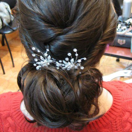Wedding hair updo with hair accessory