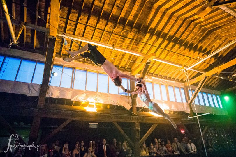 Emerald City Trapeze artists showing off their skills during a wedding. At our venue, you can hire...