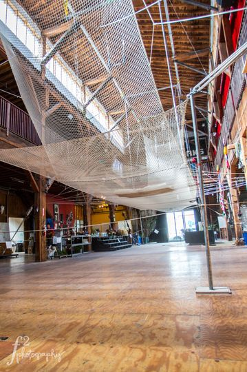 Awesome shot of the Emerald City Trapeze net. This can be taken down durn the wedding, or it can be...