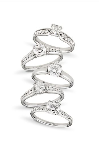 Four silver rings with diamond