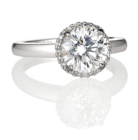 Simple silver ring with big diamond on top