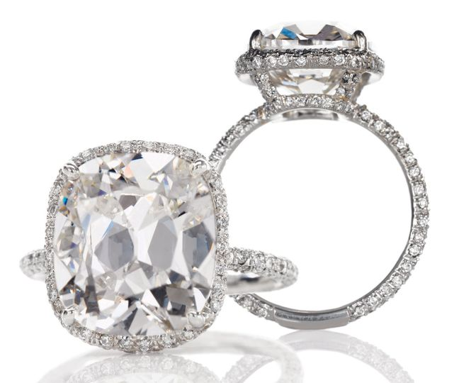 Diamond ring with crystals on the side