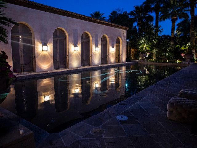 Monogram reflecting on pool