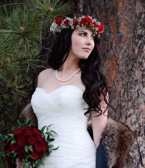 Bride with red flower crown and bouquet