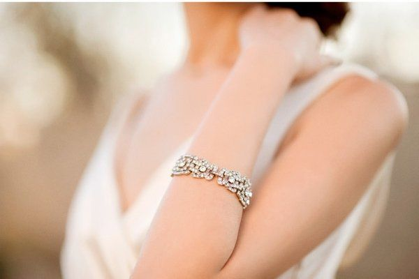 """6 strands of gorgeous freshwater pearls. Stretchable bracelet adjusts for a universal fit.  2.5"""" -..."""