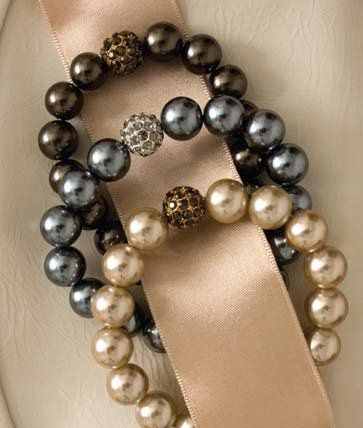 these pearls are a classic! 4 luscious strands of fresh water pearls and coin pearls. Notice the...