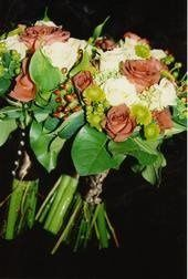 These are matching hand tied bridal bouquets made up of roses and hydrangeas.