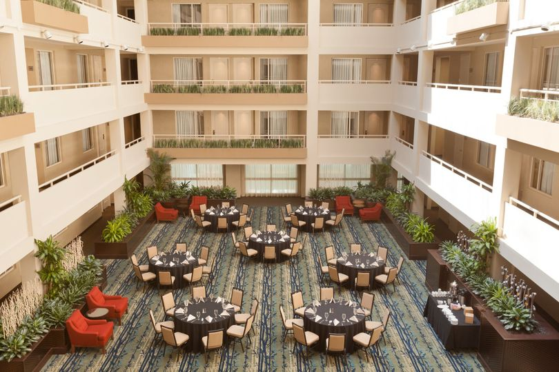 Mezzanine level- a gorgeous setting at the base of our 8 floor guestroom atrium.