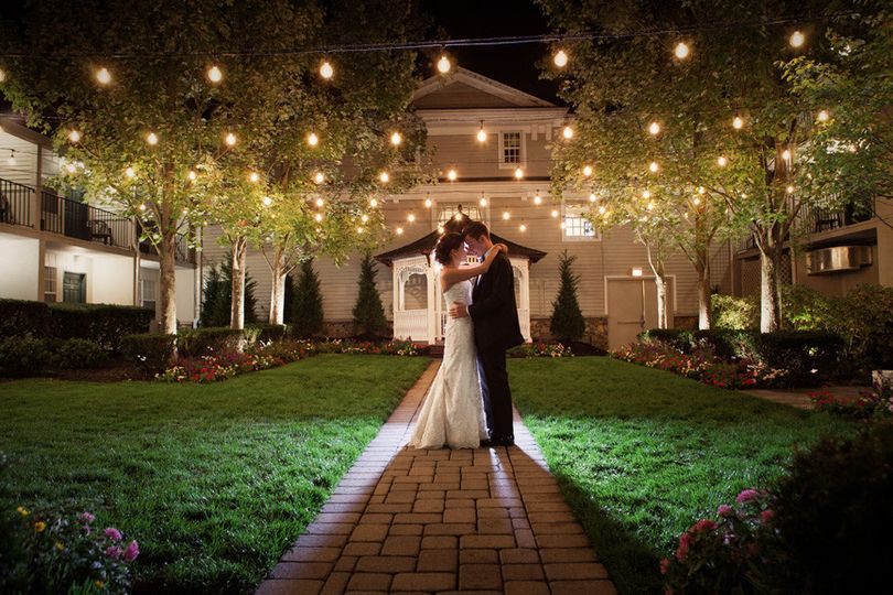 Bride and groom in the courtyard of the olde mill inn