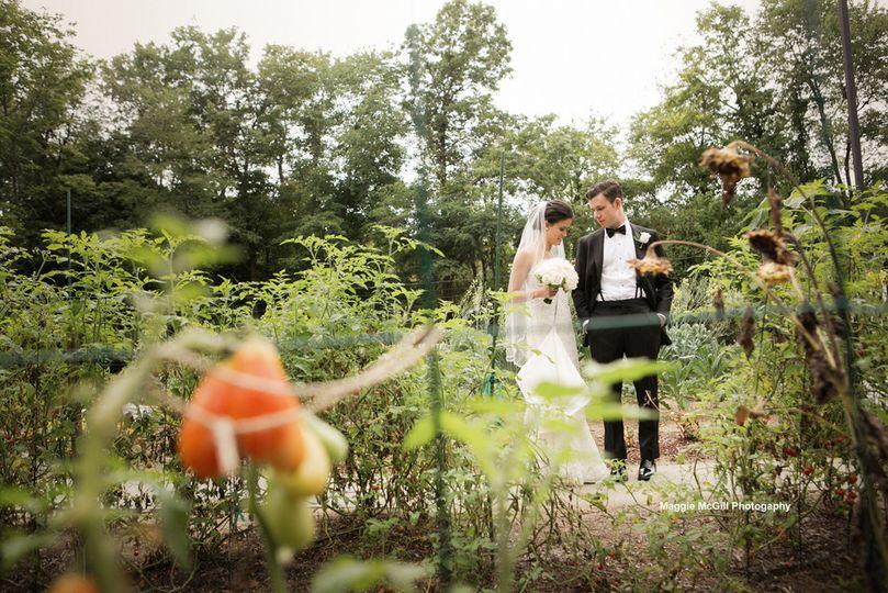 Wedding couple in the grain house organic garden