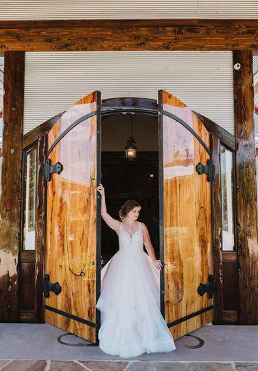 Bride posing by the door