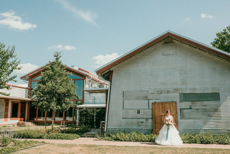 Bride by the barn