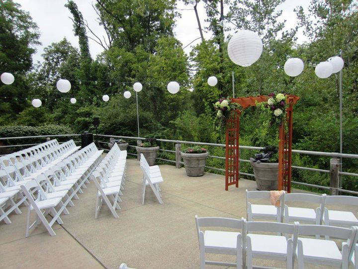 Patio Ceremony with Rented Chairs and Trellis