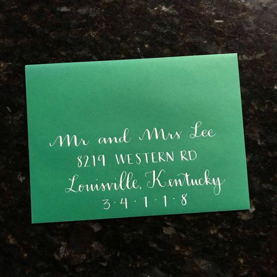 Green envelope, white ink