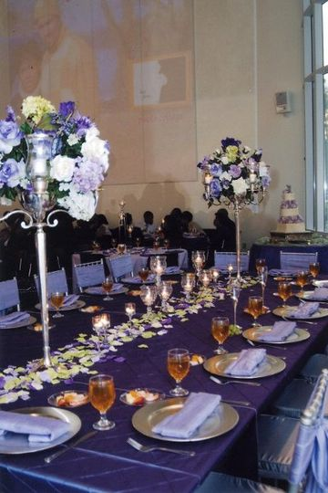Purple Majesty is the name for this luxurious headtable, with tall candelabras filled with...