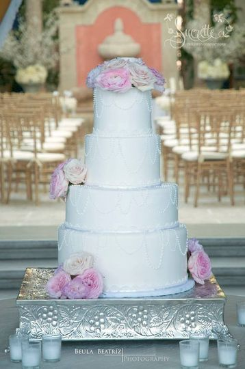 4-tier wedding cake with flowers