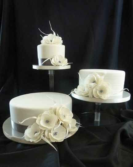 modern white wedding cake with sugar flowers