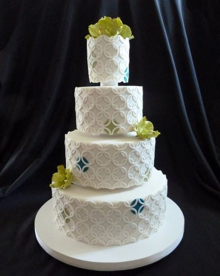 modern white wedding cake with geometric patterns and edible cymbidium orchids