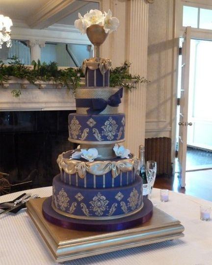 elegant purple and gold wedding cake with stenciled damask pattern and sugar orchids
