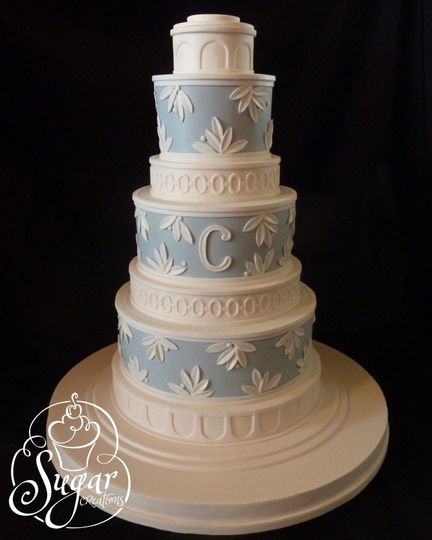 An architectural column wedding cake.  The pattern on the 2nd & 3rd seperators was meant to mimic a...