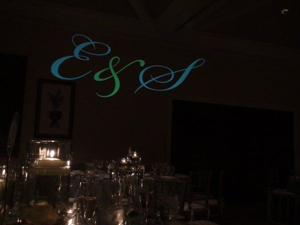 This monogram was projected on the wall, and it was designed with the wedding theme colors.