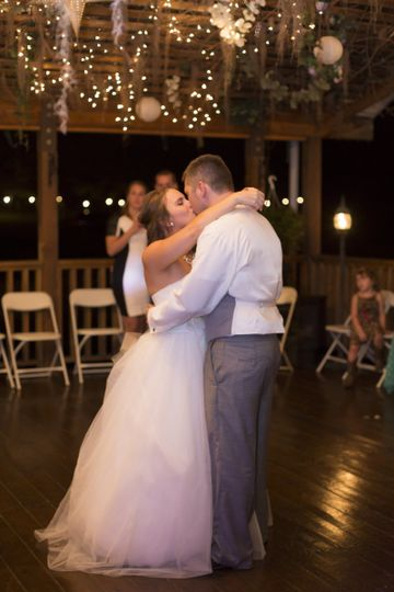 the bride and groom share a special dance