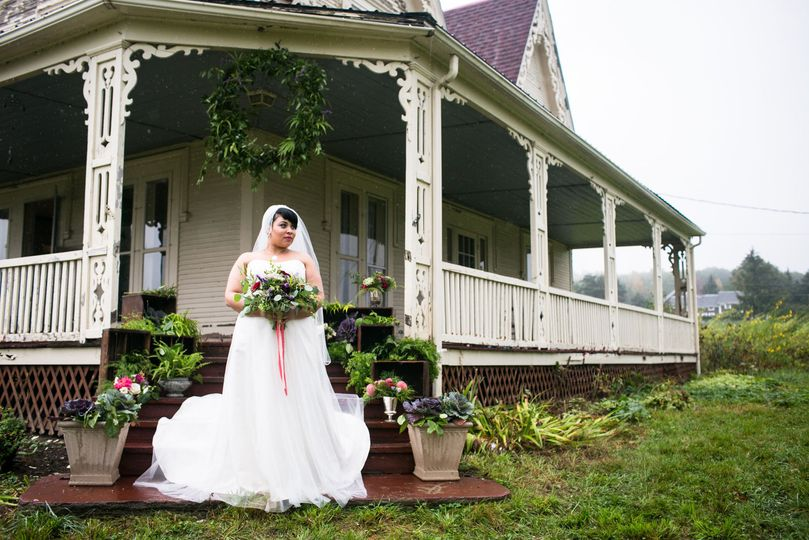 Bride in front of the farm