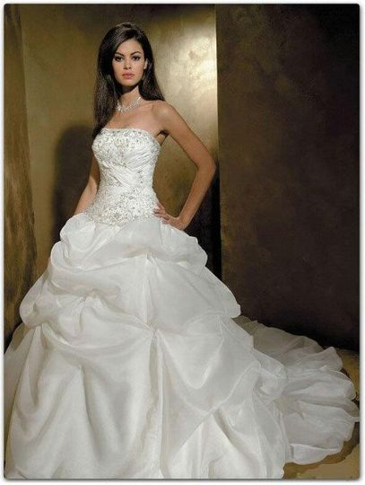 Sheer's Amilla wedding dress is an exquisite custom made couture bridal gown with ruffles, lace...