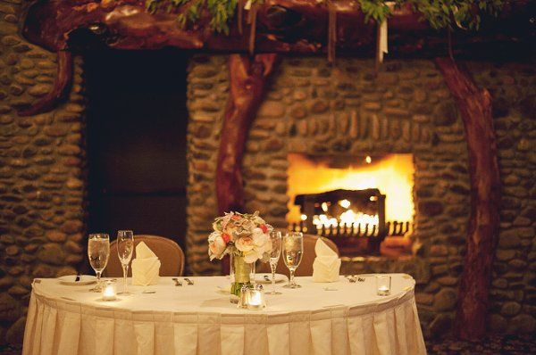 Sweetheart table for two in front of our beautiful Mesquite Hearth in the Geronimo Ballroom Photo-...