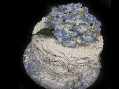 Rosette cutting cake with fresh hydrangeas