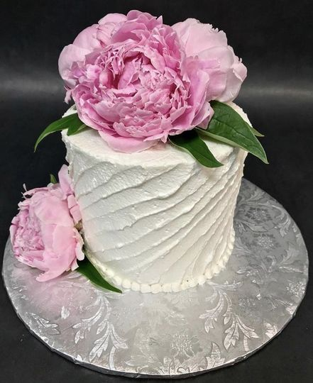 Fresh Peonies on a cutting cake